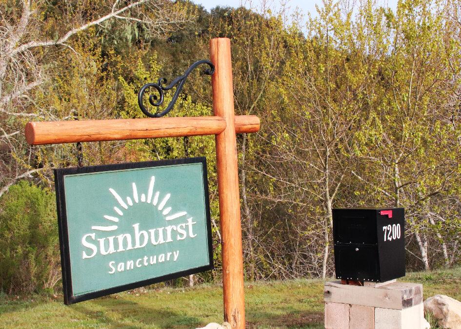 Sunburst sign and mailbox