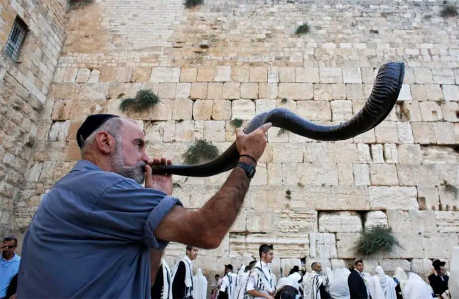 Man Blowing Ram's Horn